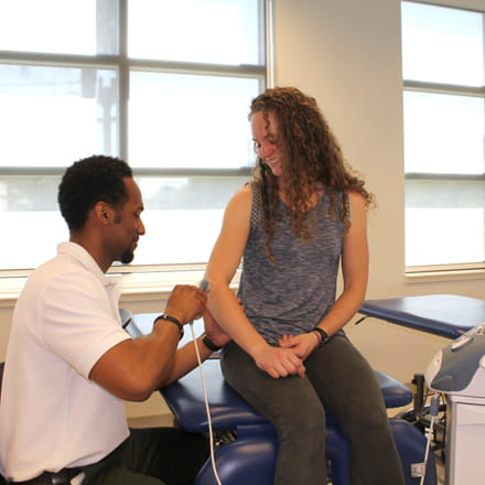 Physical therapy student with patient