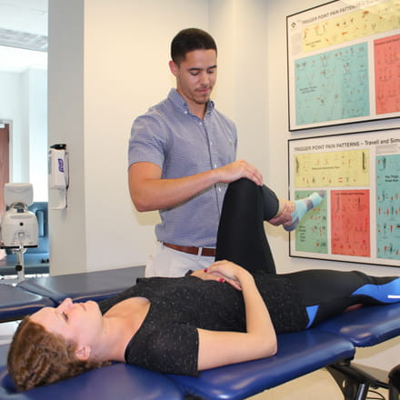 Physical therapy student with patient.