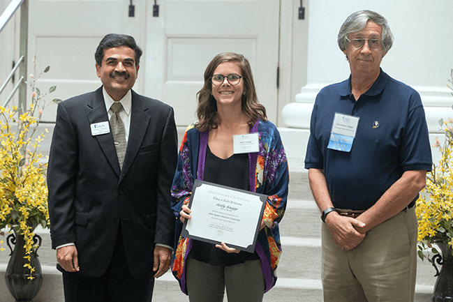 Dr. Alex Pappas and Dean Zoher Kapasi present the Anne F. Pappas Scholarship to a MUSC College of Health Professions student.