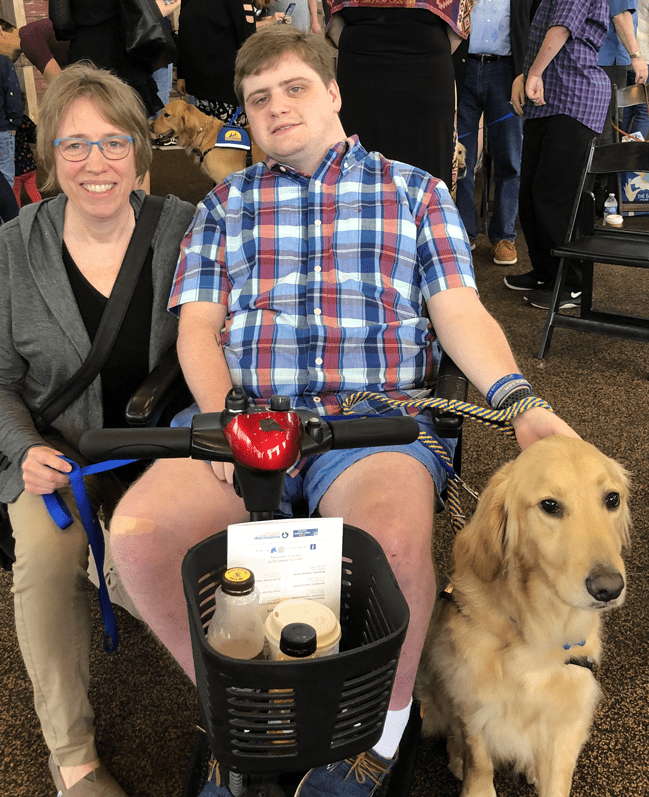 Michelle Woodbury, with Alyx and his new service dog, Thatcher.