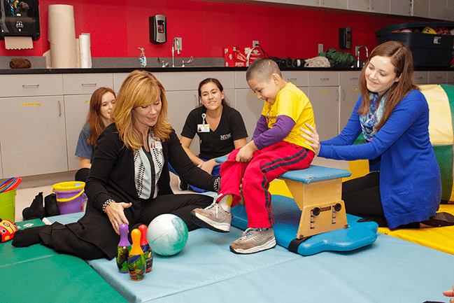 Occupational therapist working with a pediatric patient