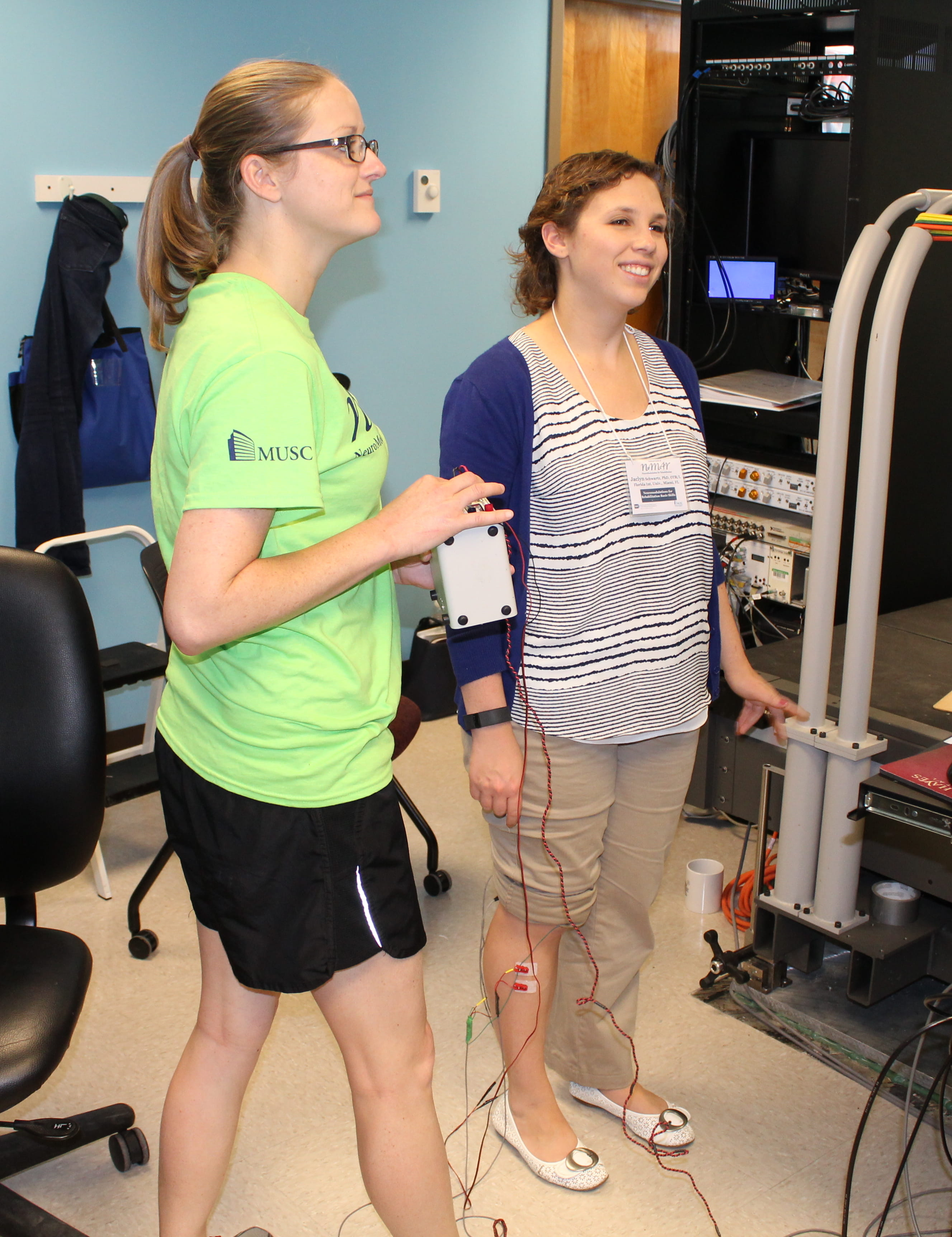 Workshop participants demonstrating Operant Conditioning of EMG-evoked potential