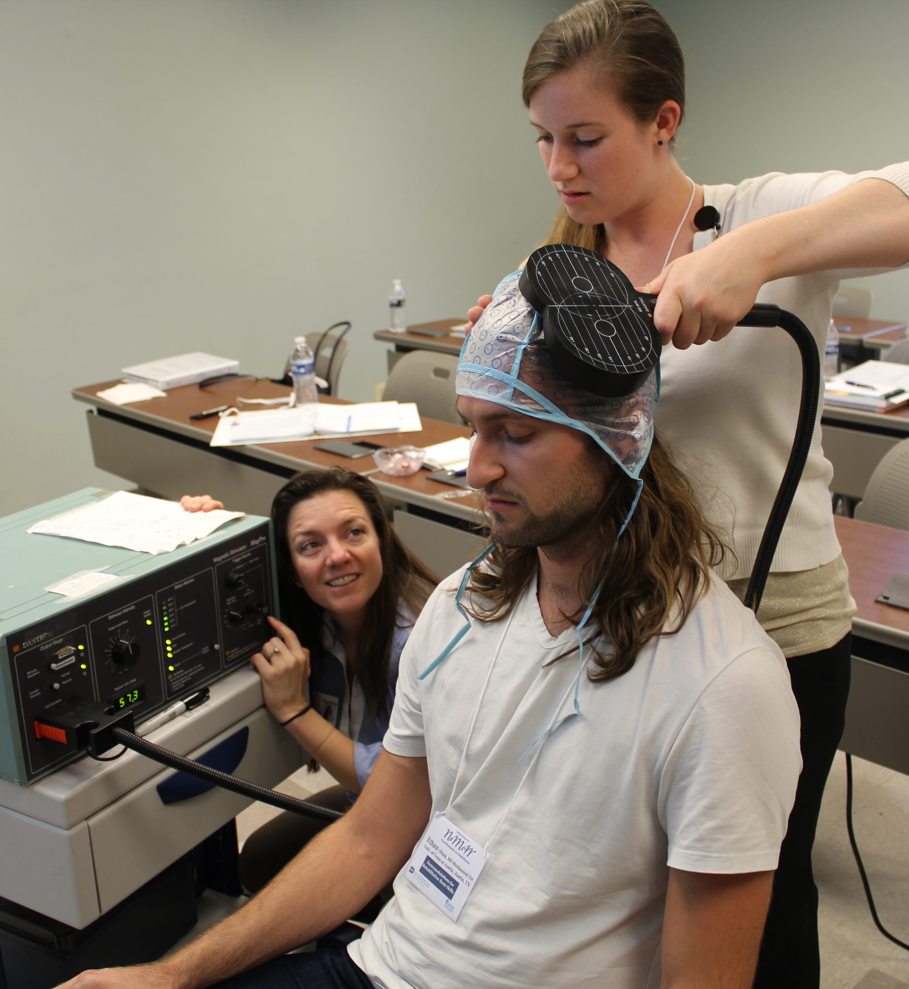 Training attendees in using transcranial magnetic stimulation during the introductory workshop.